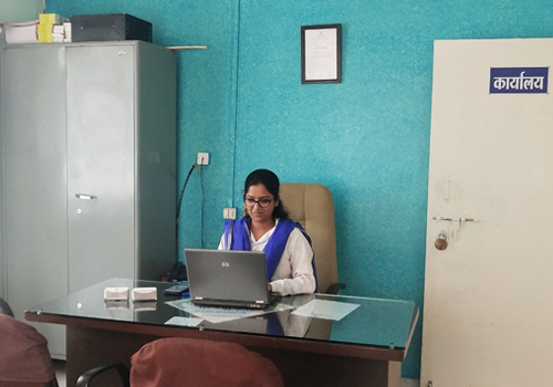 Principal in her office.